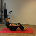 Video: Pilates Half Roll Back